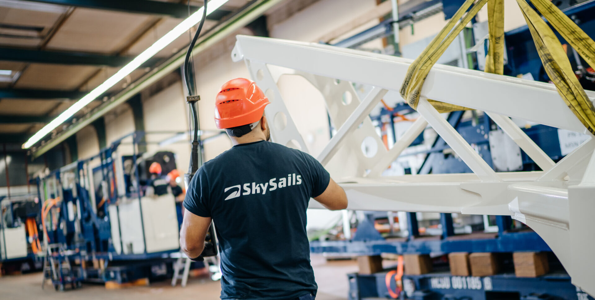 Mechanic assembling airborne wind energy system launch and landing mast at SkySails Power production site.