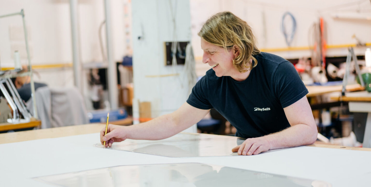 Wind Energy is our Passion: Sailmaker designing a power kite for a SkySails Power airborne wind energy system.